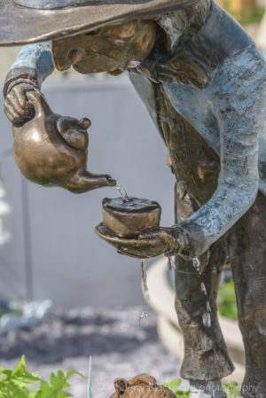 The Mad Hatter bronze sculpture / water feature (at RHS Chelsea Flower Show) by Robert James Workshop
